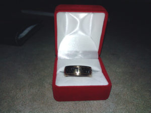 Blessed by God wedding ring in box.