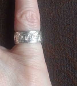 Silver Ring on Pinkie Finger
